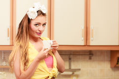 Pretty pin up girl drinking tea or coffee at home. Stock Image