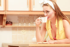 Pretty pin up girl drinking tea or coffee at home. Royalty Free Stock Photography