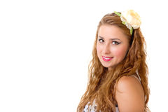 Pretty pin up girl with flower in her long curly hair Royalty Free Stock Photos