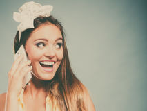 Pretty pin up girl woman talking on mobile phone. Stock Photography