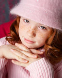 Pretty in pink. Young girl in pink top and hat Stock Photography