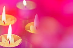 Pretty pink background with glowing candles Royalty Free Stock Photos