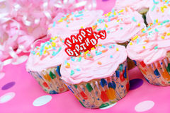 Pretty pink birthday cupcakes Stock Image