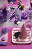 Pretty pink birthday party table. Pink and purple theme party table setting decoration, with party hat and plate table setting - vertical Stock Images