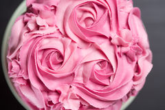 Pretty pink cake with icing sugar roses Stock Photo