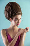 Pretty in pink with couture hair style Stock Photo