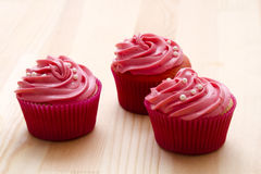 Pretty pink cupcake Stock Images