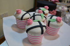 Pretty in pink. Cupcakes matching bridal shower theme Stock Images