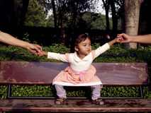 Pretty in Pink dress. A small girl playing with her family members Royalty Free Stock Photos