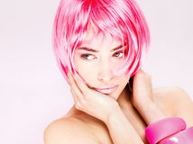 Pretty pink hair woman. Portrait of a pretty young pink hair woman royalty free stock photos