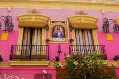 Pretty pink house with medinaceli christ lord of almeria Royalty Free Stock Image