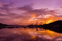 Pretty Pink orange Sky cloudscape over an island Royalty Free Stock Images