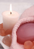 Pretty In Pink Spa (01). Pink Spa Scene with a burning candle and sea glass Stock Photo