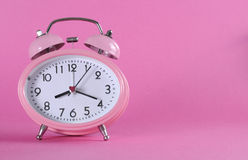 Pretty pink vintage retro style alarm clock Royalty Free Stock Photo