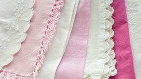 Pretty pink and white table linens Stock Image