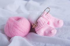 Pretty pink woolen baby socks on white background Royalty Free Stock Images