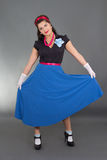 Pretty pinup girl in blue skirt Stock Photography