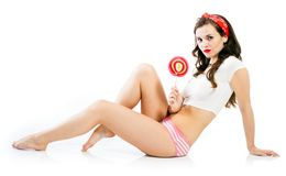 Pretty pinup girl in panties with big lollipop Royalty Free Stock Photography