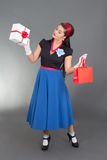 Pretty pinup girl with presents Stock Photo