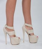 Pretty in platform leather heels Stock Images