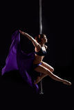 Pretty pole dance woman with purple fabric Royalty Free Stock Photos