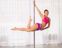 Pretty pole dancer woman Royalty Free Stock Image