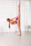 Pretty pole dancer woman Stock Photo