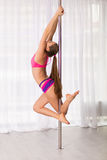 Pretty pole dancer woman Royalty Free Stock Images