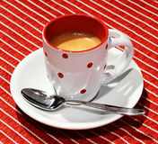 Pretty polka dot cup of Italian espresso Royalty Free Stock Image