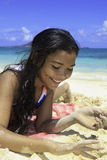 Pretty polynesian girl at the beach Royalty Free Stock Image