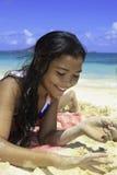 Pretty polynesian girl at the beach. Portrait of a pretty polynesian girl at the beach in hawaii Royalty Free Stock Image