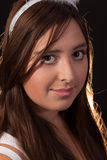 Pretty Portrait. Head of young brunette Hispanic teen girl with brown eyes and long hair Royalty Free Stock Photography