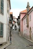 Pretty Portuguese cobbled street in Porto. Portugal, Europe. Traditional old houses along a small empty lane royalty free stock photography