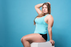 Pretty posing sitting chubby lady Royalty Free Stock Images