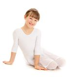 Pretty positive the girl athlete in a white sports. Leotard sits on the floor- isolated on white background Stock Photos