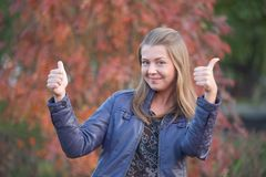 Pretty positive girl with thumbs up Stock Photography