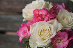Pretty Posy. Pretty, small posy of cream roses and pink fuchsia , tied bouquet for wedding decoration or gift, shabby chic Royalty Free Stock Photography