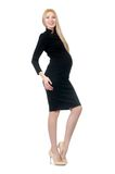 Pretty pregnant woman in black dress isolated on Stock Image