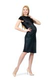 Pretty pregnant woman in black dress isolated on Stock Photos