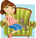 Pretty pregnant woman with cat in green armchair Royalty Free Stock Image