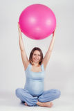 Pretty pregnant woman doing exercise with big gymnastic ball Royalty Free Stock Photos