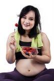 Pretty pregnant woman eats strawberry Stock Photography