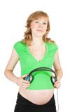 Pretty pregnant woman with headphones Royalty Free Stock Images