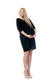 Pretty pregnant woman in mini black dress isolated Stock Photo