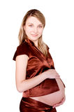 Pretty pregnant woman over white Royalty Free Stock Photography