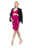 Pretty pregnant woman in pink dress isolated on Stock Images