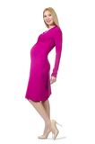 Pretty pregnant woman in pink dress isolated on Stock Photo