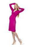 Pretty pregnant woman in pink dress isolated on Royalty Free Stock Photo