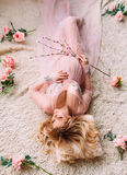 Pretty pregnant woman. In pink, transparent negligee. waiting for baby Royalty Free Stock Photography