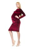 Pretty pregnant woman in red dress isolated on the Stock Photography